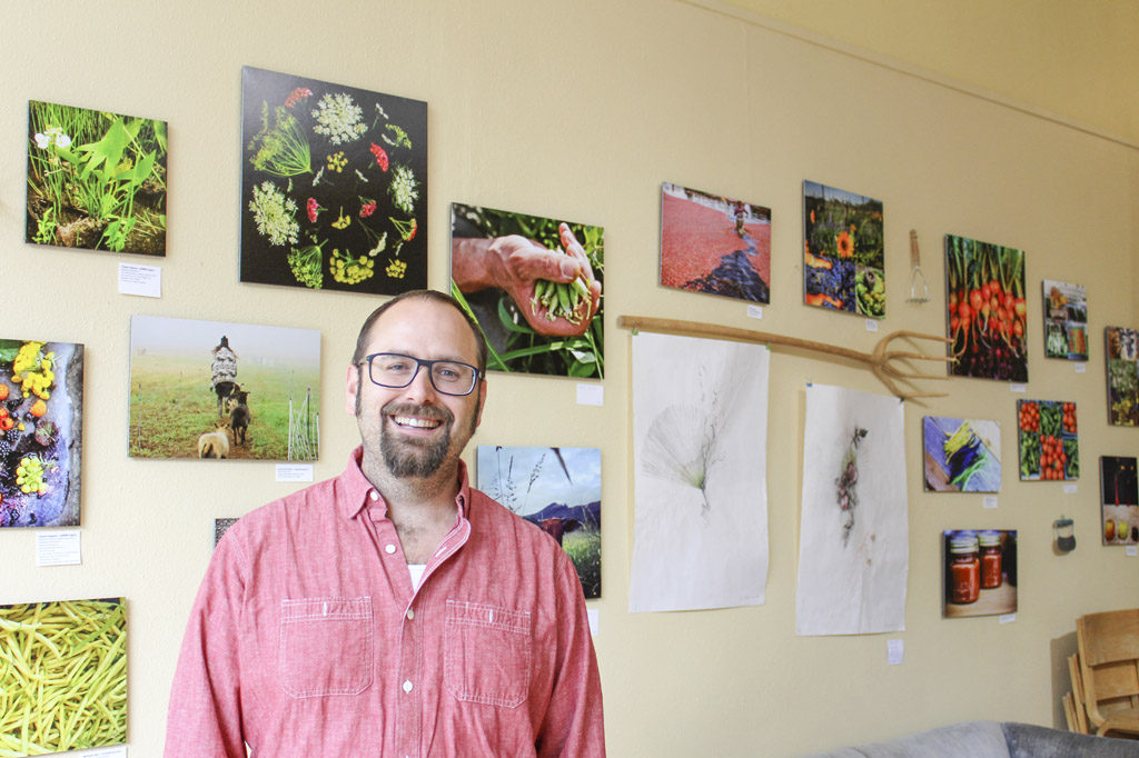 Warren Neth, executive director of Slow Food Southwest Washington, stands inside the Angst Gallery in downtown Vancouver, where his group's art exhibit, Food Culture of Southwest Washington, runs through Oct. 29. Angst Gallery is located at 1015 Main St., Vancouver. Photo by Kelly Moyer