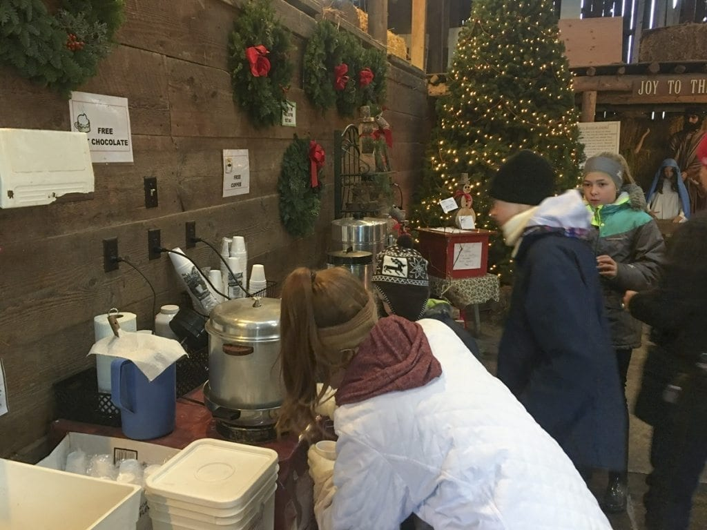 Inside the old rustic barn, you will find plenty of handmade gifts to round out your gift shopping as well as a heater, free coffee and cocoa to warm your hands. Photo by Andi Schwartz