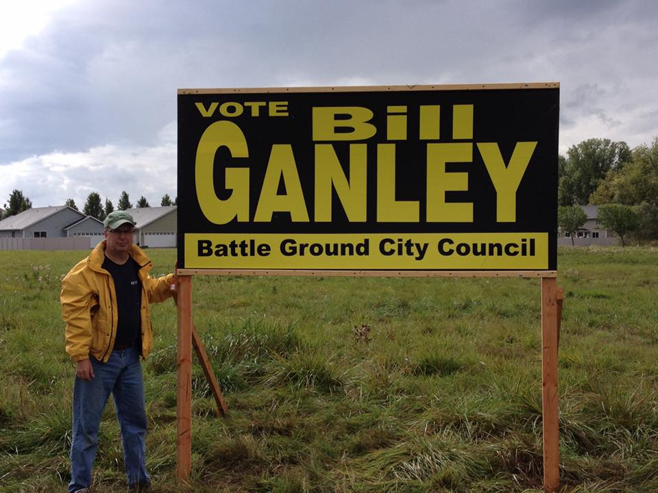 Late Battle Ground City Council Member Bill Ganley is shown here putting up campaign signs the last time he ran for re-election to the council. Ganley passed away Saturday morning after fighting carcinoid cancer. Photo from Shane Bowman's Facebook page