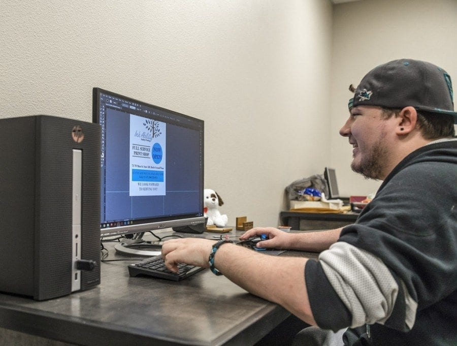 Joseph Wright is currently working as the graphic designer at Ink Ability, Battle Ground's newest print shop, which opened for business on Feb. 6. Photo by Mike Schultz