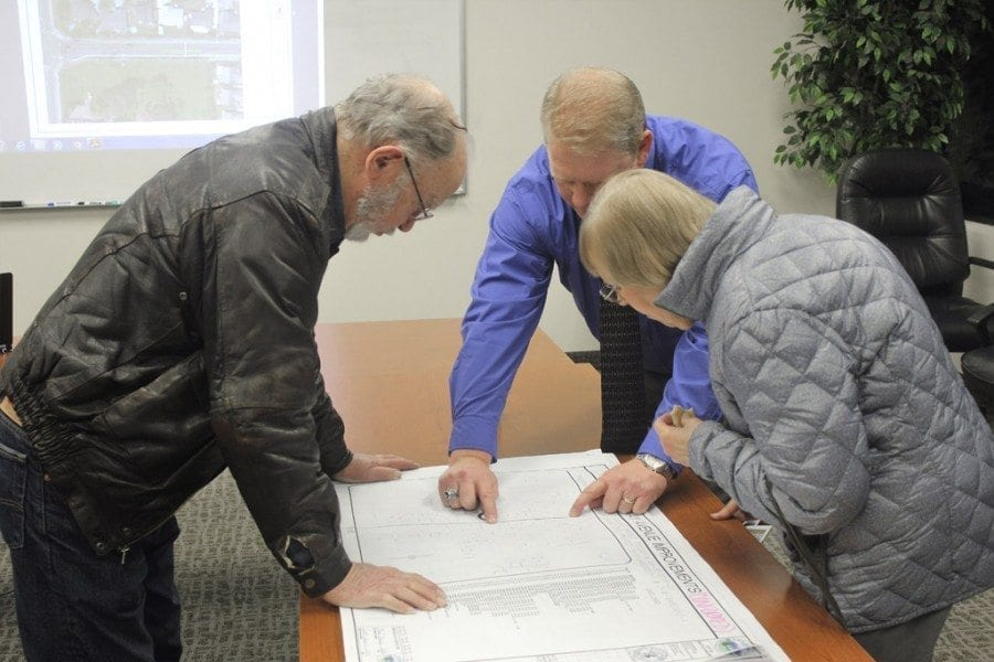 Battle Ground Public Works Director Scott Sawyer (center) explains some of the details of the plans for the South Parkway Improvement Project to Battle Ground residents Bill and Louise Tucker during an informational open house on Tuesday evening. Photo by Joanna Yorke