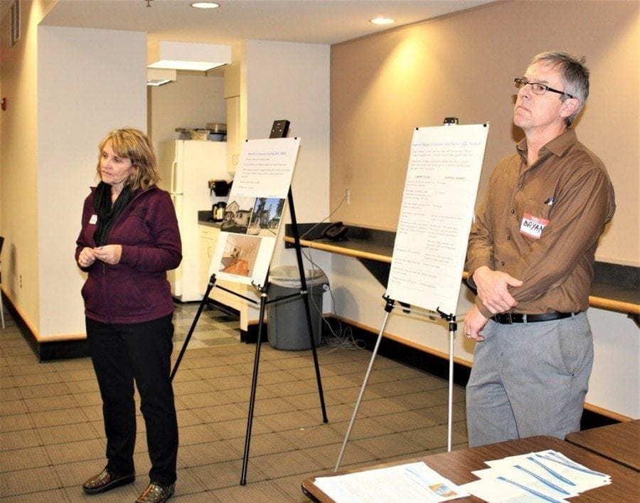 Vancouver city officials Peggy Sheehan (left) and Bryan Snodgrass (right) present information about proposed changes to the city's accessory dwelling unit standards at an open house held Tue., March 7 at the Vancouver Housing Authority. Photo by Kelly Moyer