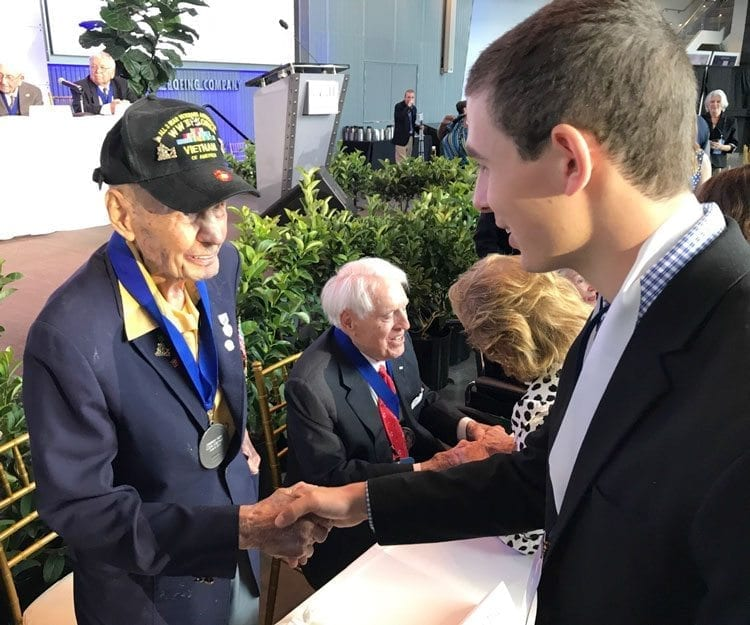 "Mitchell Leon, a senior from Washougal High School, shakes hands with retired Sgt. Major Mike ""Iron Mike"" Mervosh at the American Spirit Awards in New Orleans. Mervosh, an Iwo Jima survivor, served in Korea and Vietnam, as well. Photo courtesy of the Leon family"