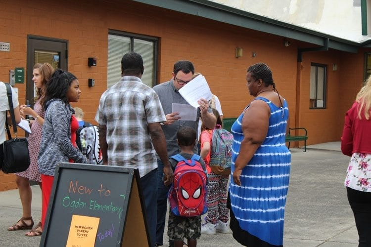 Faculty and staff at Ogden Elementary School in Vancouver were on hand to welcome students back Wednesday, as well as help students and families find classrooms. Photo by Alex Peru