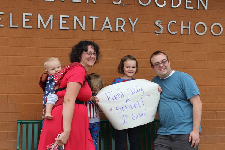 For some, the first day of school Wednesday was a time for family celebration. Photo by Alex Peru