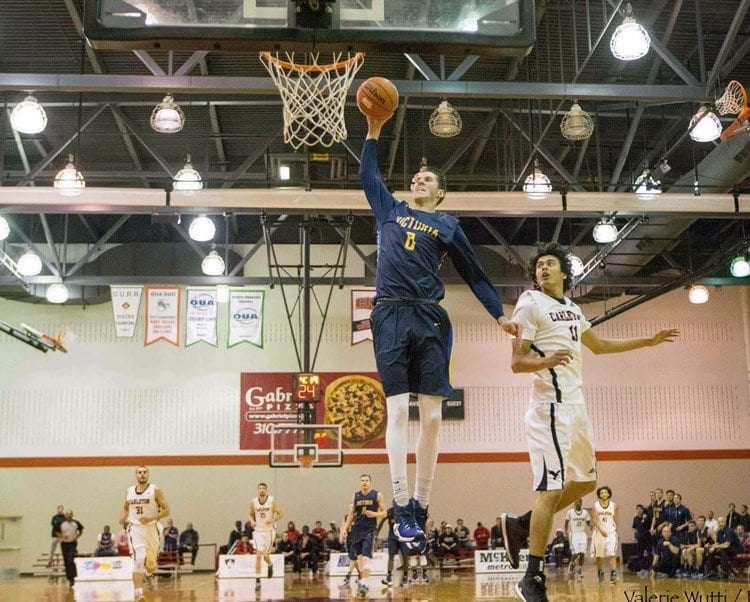 Grant Sitton soars to the hoop while playing for the University of Victoria in Canada. The 2011 Prairie High School graduate took a while to develop his game but now is overseas preparing for his first season of pro ball. Photo courtesy of Sitton family