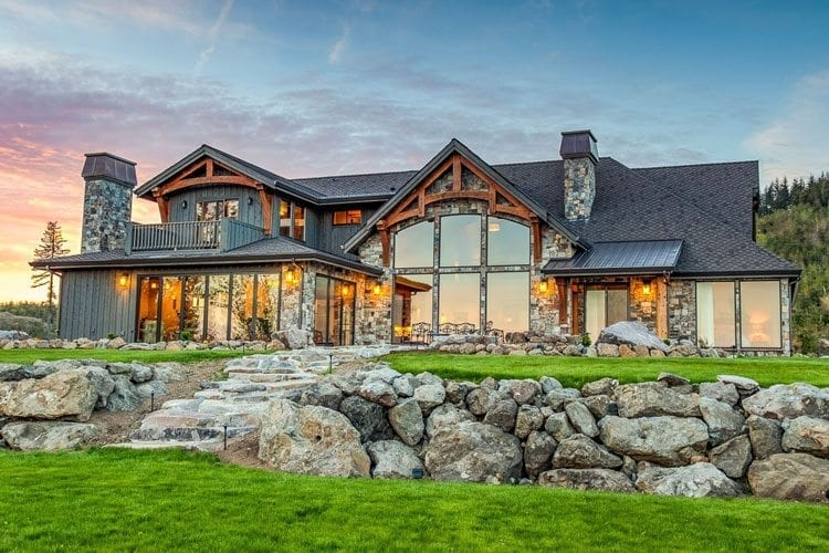 Some of Arrow Timber Framing's projects focus on timber frame accents that complement the overall exterior design of a house. Photo by Mike Schultz