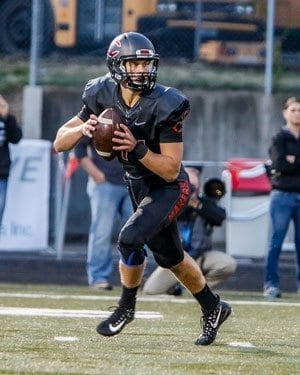 Camas quarterback Kyle Allen (14) engineered a game-winning drive in the final minute of Friday's game. Allen hit teammate Drake Owen with the game-winning touchdown with 20 seconds left to play to give the Papermakers a 28-25 victory over Coeur d'Alene. Photo by Mike Schultz
