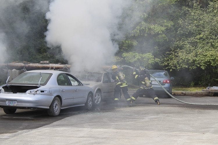 Crowds were treated to a demonstration of firefighters extinguishing a burning car, and got a firsthand look at the process. Photo by Alex Peru