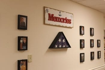 The Memories portion of the Hall of Honor displays photos of veterans that have lived at Columbia Ridge in the past and have moved, and also provides a special place for those veterans that have passed away to be remembered. Photo by Alex Peru