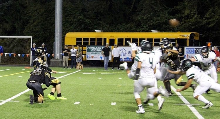 Hudson's Bay kicker Nick Campbell is shown here booting a game-winning field goal against Woodland last week. Campbell now has two game-winning field goals this season for the Eagles. Photo courtesy of Aaron Morse