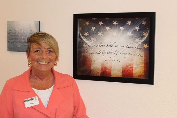 Executive Director Lori Anderson of Columbia Ridge Senior Living spearheaded the Hall of Honor project as a way to show respect and honor to American veterans. Photo by Alex Peru