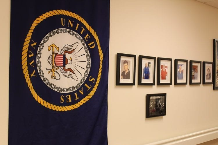 Each branch of the service is represented in the Hall of Honor by a flag and photos of the residents who served in that branch. Photo by Alex Peru