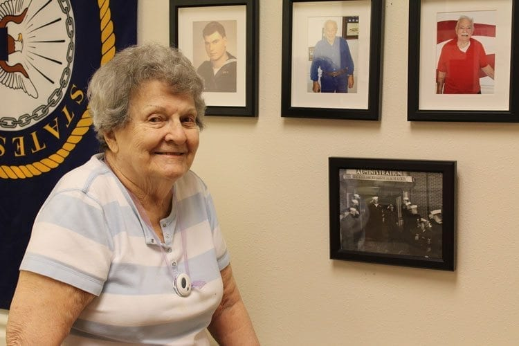 Jean Russell proudly stands by a photo of her husband, Navy veteran Charles A. Russell, at the Sand Point Naval Air Station. Photo by Alex Peru