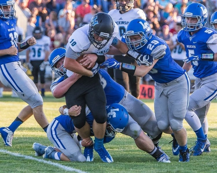 La Center's defense held Ridgefield to just 7 points in Week 3. Several Wildcats defenders are shown here swarming a Hockinson ball carrier earlier this season. Photo by Mike Schultz