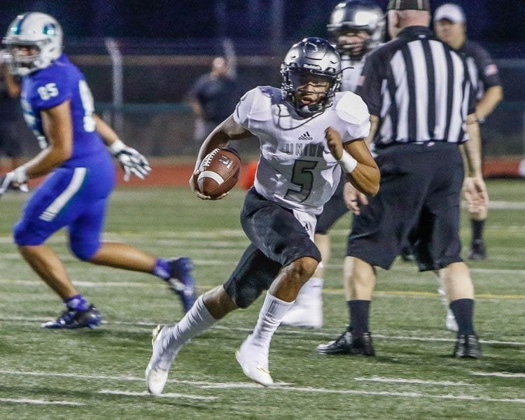 Union quarterback Lincoln Victor (5) and the Titans will attempt to bounce back from a loss to Eastside Catholic on Friday against Tumwater. Photo by Mike Schultz
