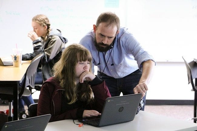River Online Learning science instructor Luke Moorhead is shown here assisting 9th grader Rylee Fehr recently. Photo courtesy of Battle Ground Public Schools