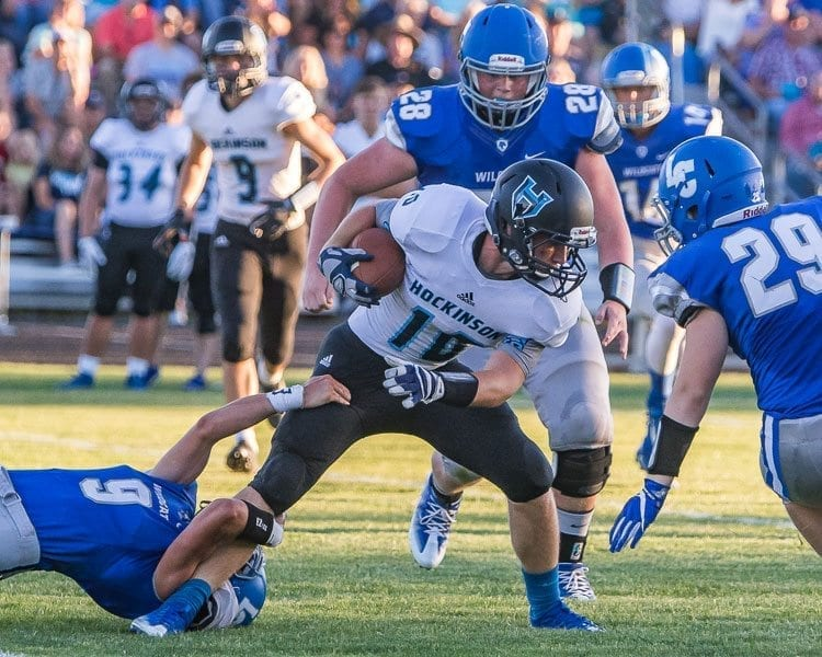 Hockinson's Kyle Brabec (10) is shown here attempting to elude La Center defenders in a game earlier this season. Brabec had a big play on defense in the Hawks' win over Mark Morris last week. Photo by Mike Schultz