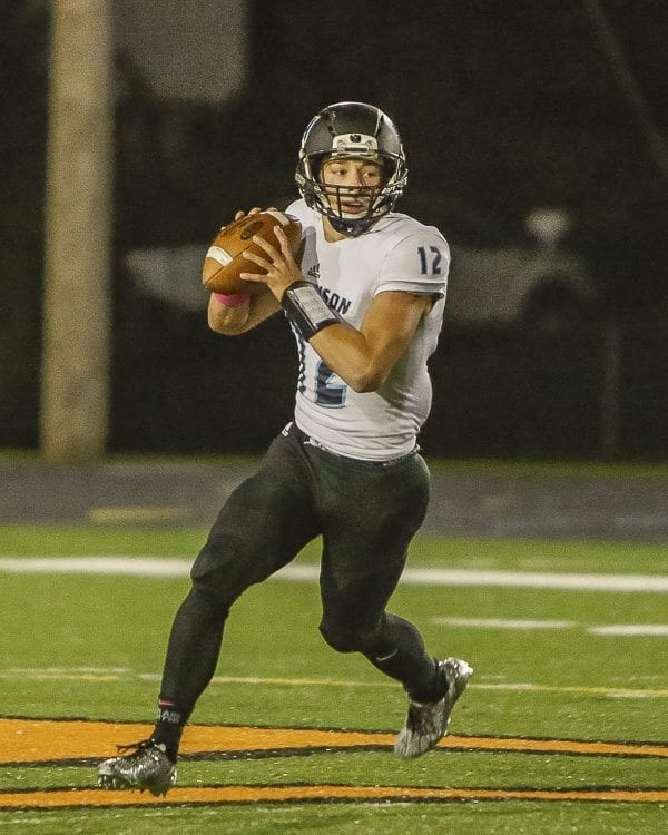 Hockinson quarterback Canon Racanelli (12) completed 24 of his 28 passes for 331 yards and four touchdowns in Friday's win at Washougal. Photo by Mike Schultz