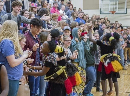 Following their performance at Woodland High School, choir members of I Am Family ran into the audience to introduce themselves, shake hands, give high-fives, and hug Woodland students. Photo courtesy of Woodland Public Schools