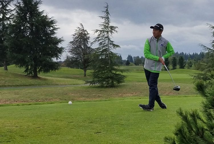 Willy Yeh tees off in a playoff at the Class 3A district boys golf tournament Tuesday at Tri-Mountain Golf Course. Yeh, a freshman from Mountain View, won the title on the first playoff hole. Photo by Paul Valencia