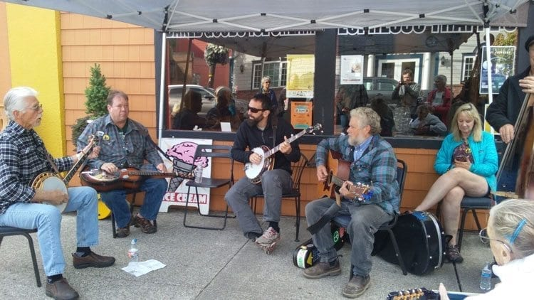 Bluegrass musicians performed at various venues throughout downtown Ridgefield on Saturday, including this group outside the Old Liberty Theater. Photo by Alex Peru