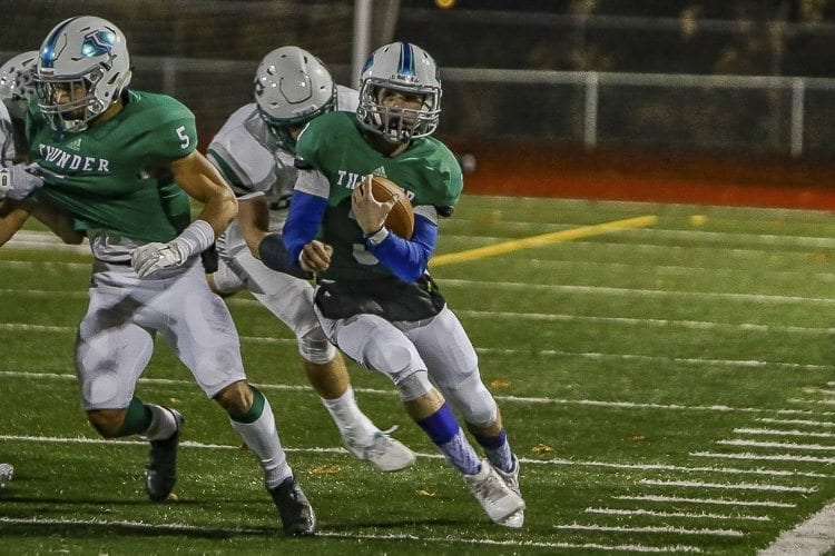 Mountain View quarterback had 61 of his 117 yards rushing on the drive that got the Thunder in position to tie the game. Peninsula, however, blocked the field goal, leading to a 10-7 win for the Seahawks. Photo by Mike Schultz