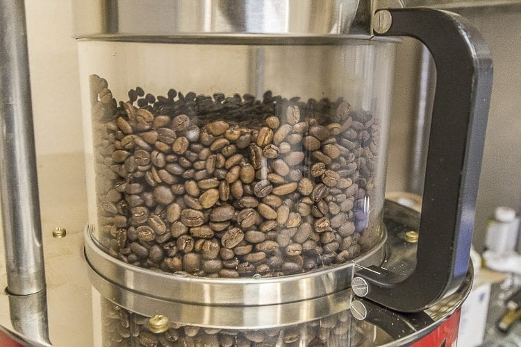 Once the roasting process is complete, the coffee beans change from a green hue to a dark brown. Photos by Mike Schultz