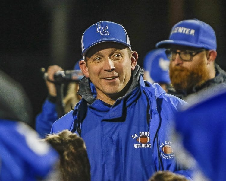 La Center coach John Lambert couldn't help but smile after his Wildcats posted yet another playoff victory Friday. Photo by Mike Schultz