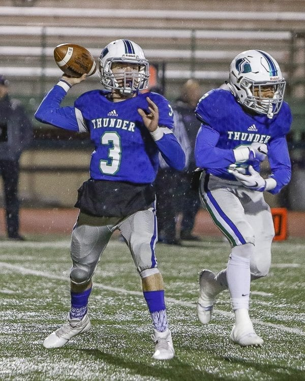Glen Perry Jr. threw for 68 yards to go with his 243 yards rushing Saturday as Mountain View advanced to the Class 3A state playoffs with a 27-10 win over Lake Washington. Photo by Mike Schultz