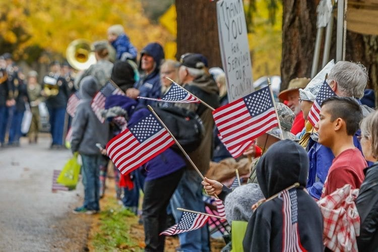 American flags were proudly displayed by many groups of marchers in the Veterans Day Parade in Vancouver on Saturday. Photo by Mike Schultz