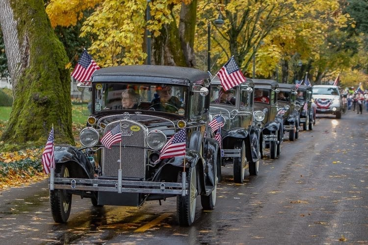 Members of the Volcano A's Model A Ford Club brought decked out their Model A Fords in American flags to honor veterans Saturday at the Veterans Day Parade in Vancouver. Photo by Mike Schultz