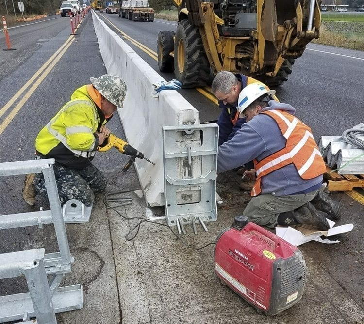 Workers from contractor Clark & Sons Excavating work to install concrete barriers on SR-503 on Fri., Dec. 1. The barriers will prevent left turns from NW 5th Way onto SR-503 or from SR-503 onto NW 5th Way behind the Fred Meyer in Battle Ground. Photo courtesy of the City of Battle Ground