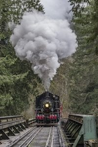 The Chelatchie Prairie Railroad's restored steam engine crosses the railroad bridge over the East Fork of the Lewis River during a Christmas tourist excursion on Saturday. Photo by Mike Schultz