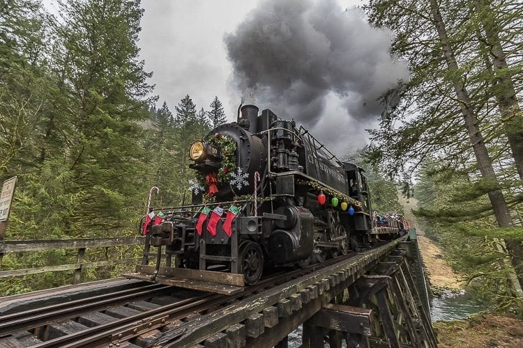 The Chelatchie Prairie Railroad's steam train crosses the wooden trestle over the Lewis River during a Christmas excursion on Saturday. The engine was decorated with Christmas ornamentation to help celebrate the upcoming holiday. Photo by Mike Schultz