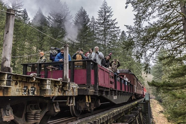 Passengers on the Chelatchie Prairie Railroad's steam excursion train had the opportunity to ride in enclosed passenger cars or experience the open air in an open flatcar. Photo by Mike Schutlz