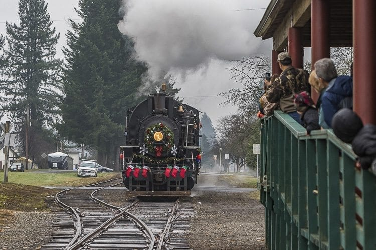Onlookers watch in excitement and anticipation as the Chelatchie Prairie Railroad's restored steam train pulls into Yacolt's train station on Saturday during the last weekend of it's holiday excursions. Photo by Mike Schultz
