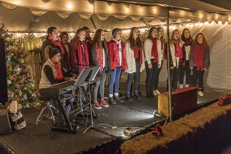 The La Center High School Select Choir sang Christmas carols to entertain visitors at La Center's annual Christmas Festival on Sunday evening. Photo by Mike Schultz