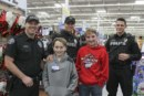 Battle Ground children shop with a cop