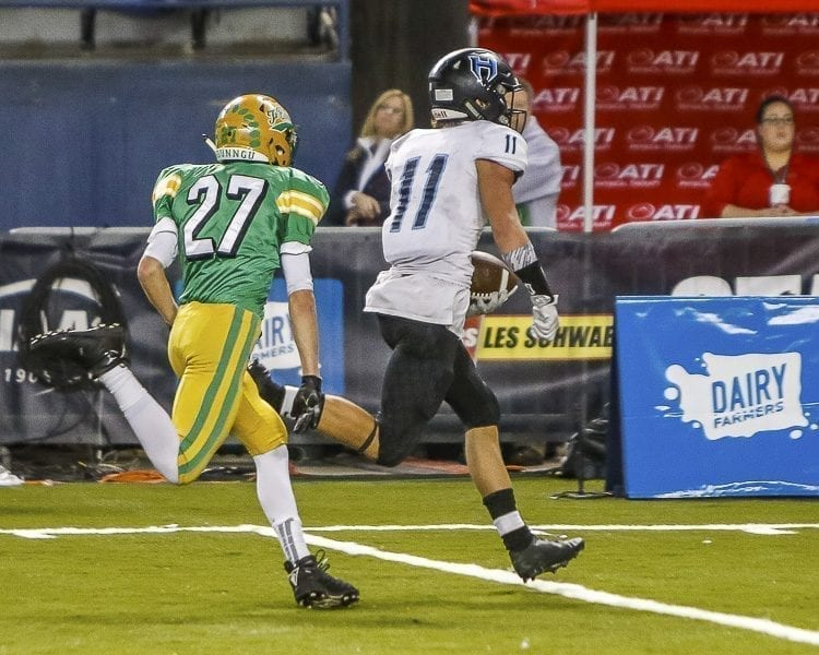 Hockinson sophomore receiver Sawyer Racanelli (11) races to the end zone on one of his three touchdowns Saturday in the Class 2A state championship game at the Tacoma Dome. Photo by Mike Schultz