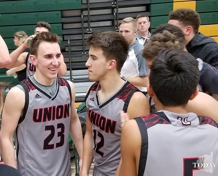 Ethan Smith (23) is all smiles after he tied Union's record with seven 3-pointers in a game Tuesday against Evergreen. Smith is one of the new players to the varsity for the Titans this season. Zach Reznick (12) is already a household name for one of the top programs in the state. Photo by Paul Valencia