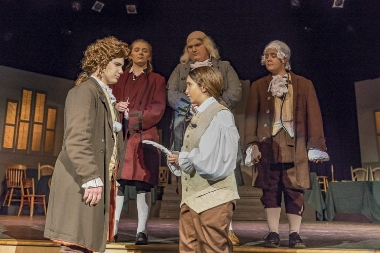 """Joshua O'Keefe (left) as Thomas Jefferson and Rowan Segura as John Adams argue over who should get the pen, who should write the Declaration of Independence in Heritage High School's production of """"1776."""" Photo by Mike Schultz"""
