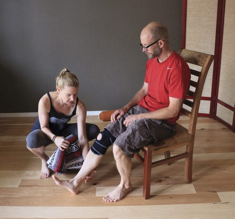 Moriah Diederich has opened up a holistic yoga studio in Vancouver. Diederich is shown here working with client Jon Suomala. Photo courtesy of Brooke Strickland