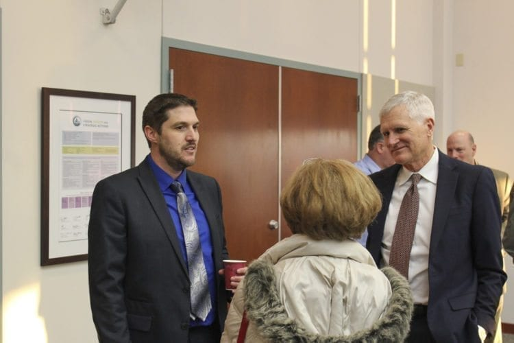 Randall Partington (left) attended an open house Monday evening to meet the public and local Clark County officials as part of a two-day interview and selection process for the new county manager. Photo by Alex Peru