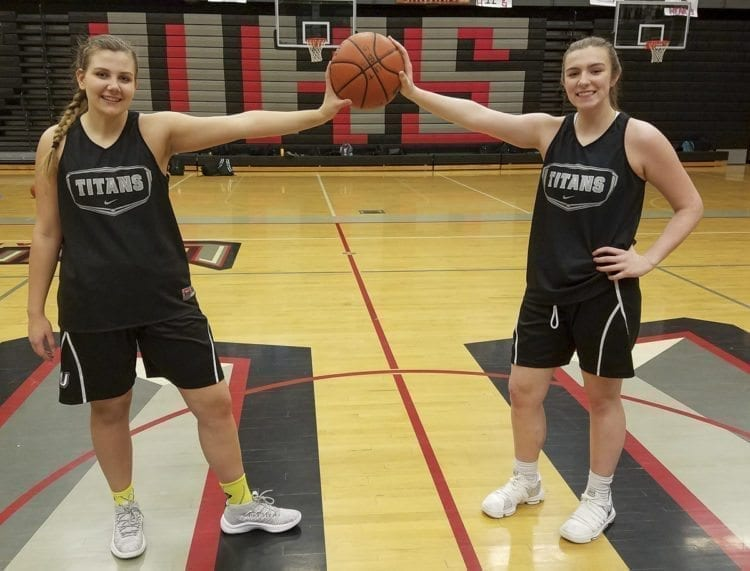 Courtney Cranston (left) and Mackenzie Lewis of Union have been close friends for years. The teammates found out in the fall that they are cousins, and they are having fun with the new discovery. Photo by Paul Valencia