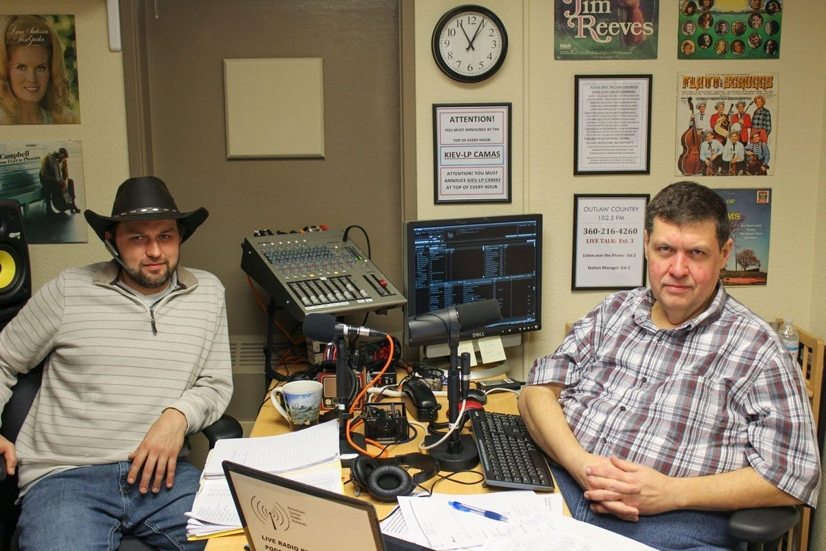 Station manager David Stepanyuk (left) and show host Gerald Gaule (right) operate the local radio station Outlaw Country 102.5 FM, a station that focuses on the community and adds a unique take on country music by focusing on the roots of the genre. Photo by Alex Peru