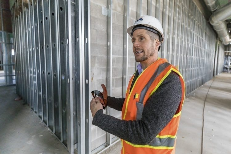 Nathan McCann, superintendent of Ridgefield School District, gives a tour of the new Grades 5-8 School Complex. Photo by Mike Schultz