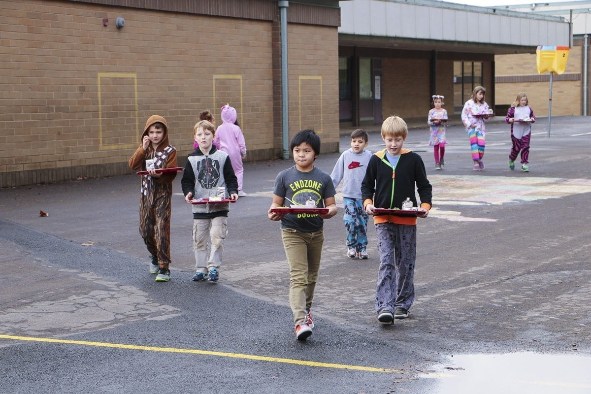Students at Pleasant Valley Primary carry their lunches from the cafeteria to their portable classrooms during lunch time. Photo courtesy Battle Ground Schools