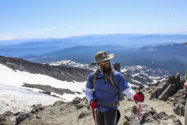A climber pauses to chat with others on the trail to the summit. Photo by Eric Schwartz