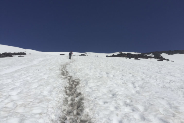A hiker makes his way up the trail to Mount St. Helens. Photo by Eric Schwartz